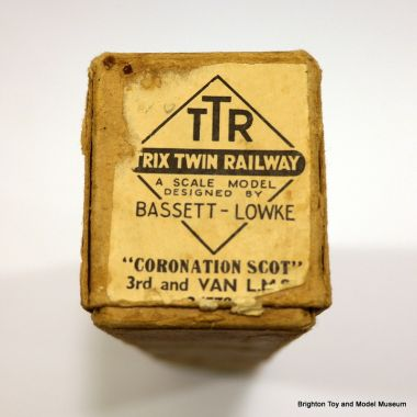 "Box end label for a TTR Coronation Scot carriage, ""A SCALE MODEL DESIGNED BY BASSETT-LOWKE"""