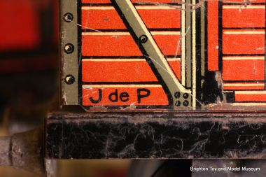 "Lithographed ""JdeP"" mark on the side of a tinplate wagon"