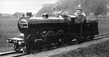 James Mackenzie at the controls of a fifteen-inch-gauge steam locomotive