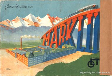 "1938 artwork showing the factory, and commemorating the company's winning of a Grand Prize (Grand Prix) in the 1937 Paris Expo (""Exposition Internationale des Arts et Techniques dans la Vie Moderne"")"