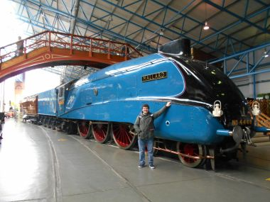 "2018: BTMM volunteer Gabriel Escudero poses with ""Mallard"" at the National Railway Museum"