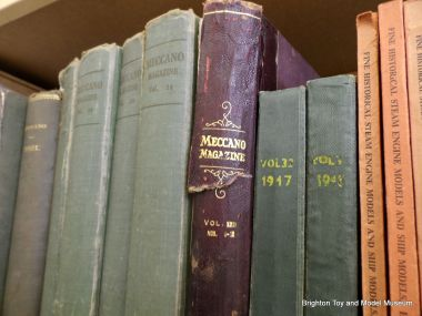 A shelf of 1920s/1930s bound copies of Meccano Magazine