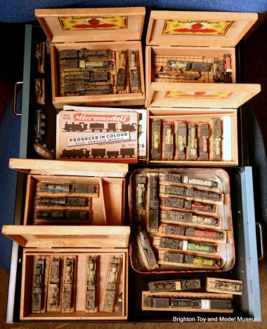Part of the Museum's archived collection of Micromodels card steam locomotive models, stored in their traditional cigar-boxes