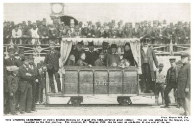 """'THE OPENING CEREMONY of Volk's Electric Railway on August 3rd, 1883, attracted great interest. The car was started by the Mayor, who travelled on the first journey. The inventor, Mr. Magnus Volk, can be seen as conductor at one end of the car."""