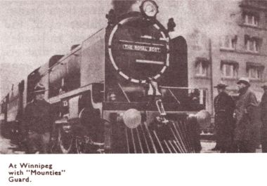 "1933: Royal Scot at Winnipeg, Canada, with ""Mountie"" guard"
