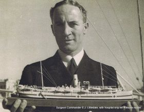 Surgeon Commander Chris Littledale holding his model of the RFA Maine