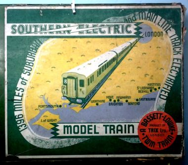 "alt=1939: Southern Railway map, TTR ""Southern"" electric train set box artwork.  This was a classic example of the SR publicity department hooking up with an outside company for mutual promotion. The train set box featured a map of popular Southern destinations, and was also specially produced in green to reference the Southern livery."