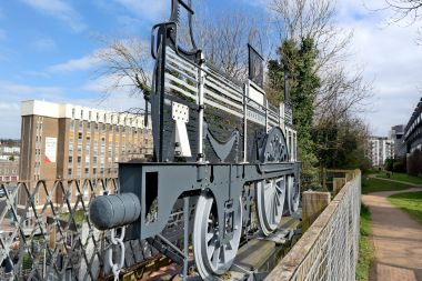 "Angled view of the ""Ghost Train"" sculpture (left), with part of the Brighton Greenway in the background (right)"