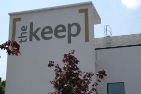 The Keep logo, painted on the building front