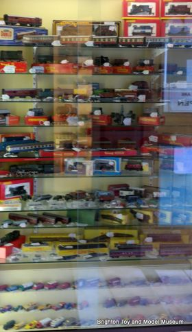Toy cars and 00-gauge cabinet (Collectors Market)