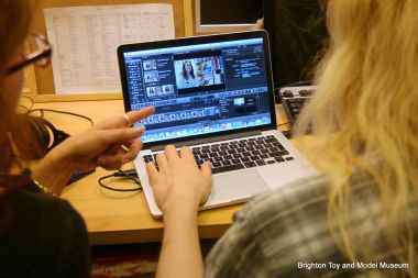 A volunteer being trained in the art of video editing