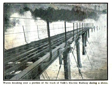 Waves breaking over the elevated and exposed Volk's Electric Railway track during a storm, Meccano Magazine 1937. Beach defences have since raised the height of the beach to match the height of the track.